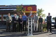 Ron, local officials and the owners of Café Yumm! in Eugene dedicate the café's new electric car charging stations.